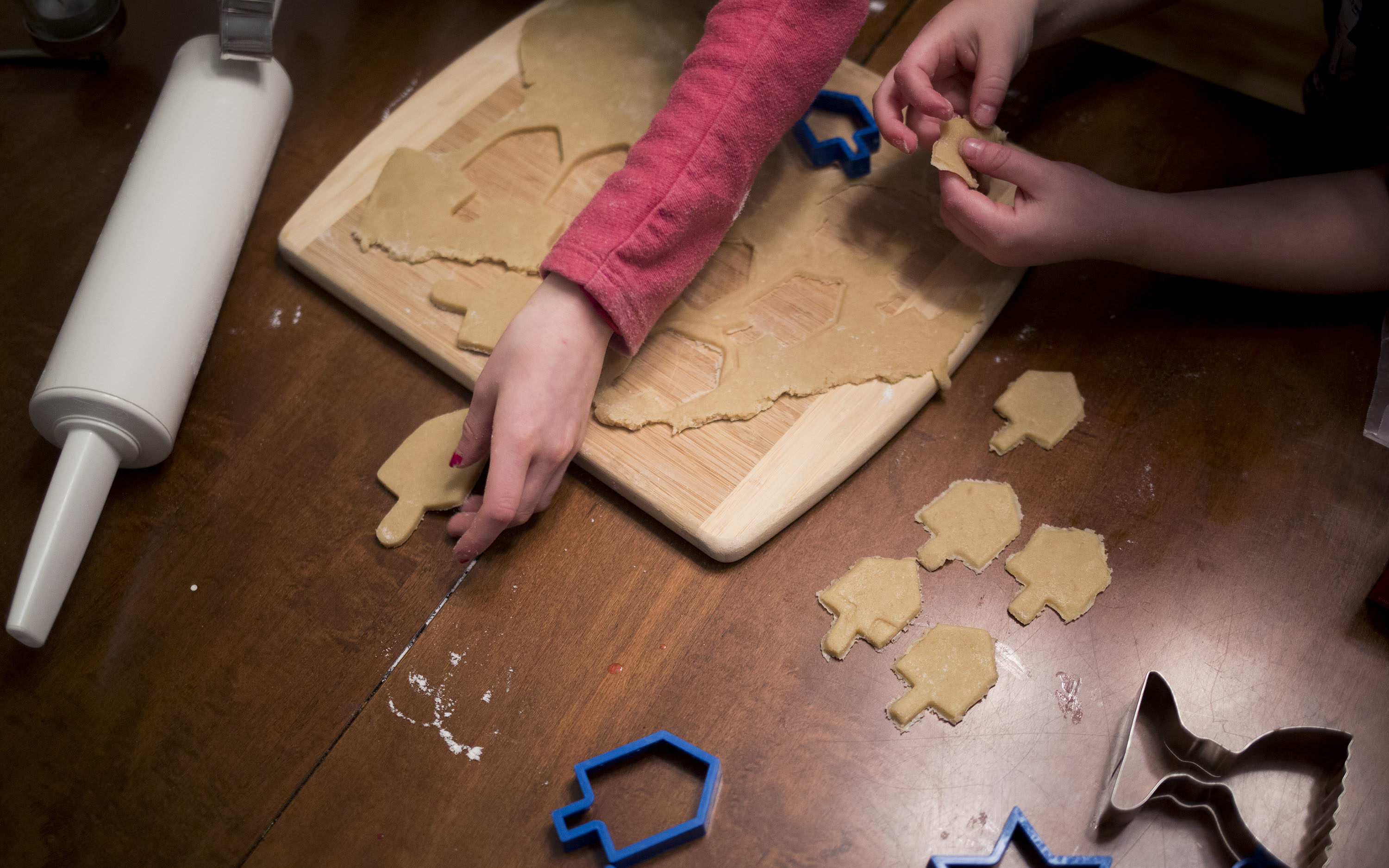 Bake-offs can add some spark to a Hanukkah party. (Photo/JTA-Brianna Soukup-Portland Press Herald-Getty Images)