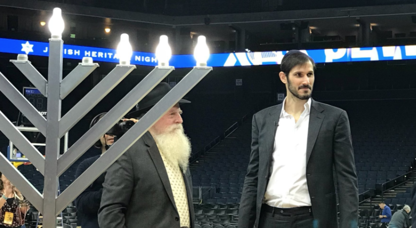 Israeli Golden State Warriors player Omri Casspi joins S.F. Chabad Rabbi Yosef Langer to light the menorah after the Warriors beat Dallas on the team's annual Jewish Heritage Night, Dec. 14, 2017 (Photo/Courtesy Golden State Warriors)