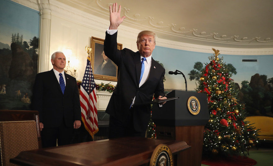 Donald Trump waving to reporters, as Vice President Mike Pence looks on, after announcing that the U.S. government will formally recognize Jerusalem as the capital of Israel in the Diplomatic Reception Room at the White House, Dec. 6, 2017. (Photo/JTA-Chip Somodevilla-Getty Images)