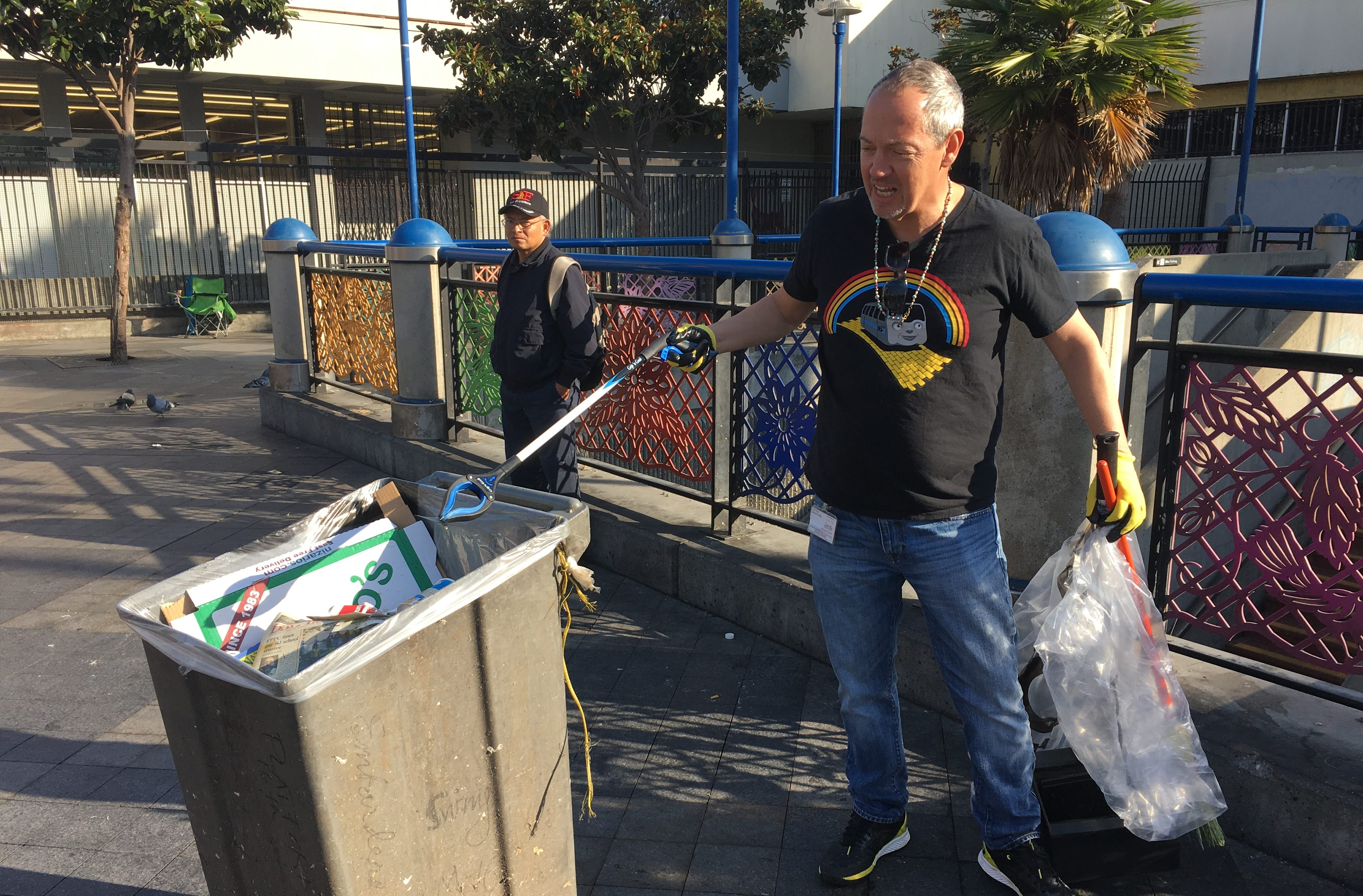 Bevan Dufty cleaning up the 16th Street Mission BART station plaza, Nov. 2017 (Photo/Courtesy Susie Neilson-Mission Local)