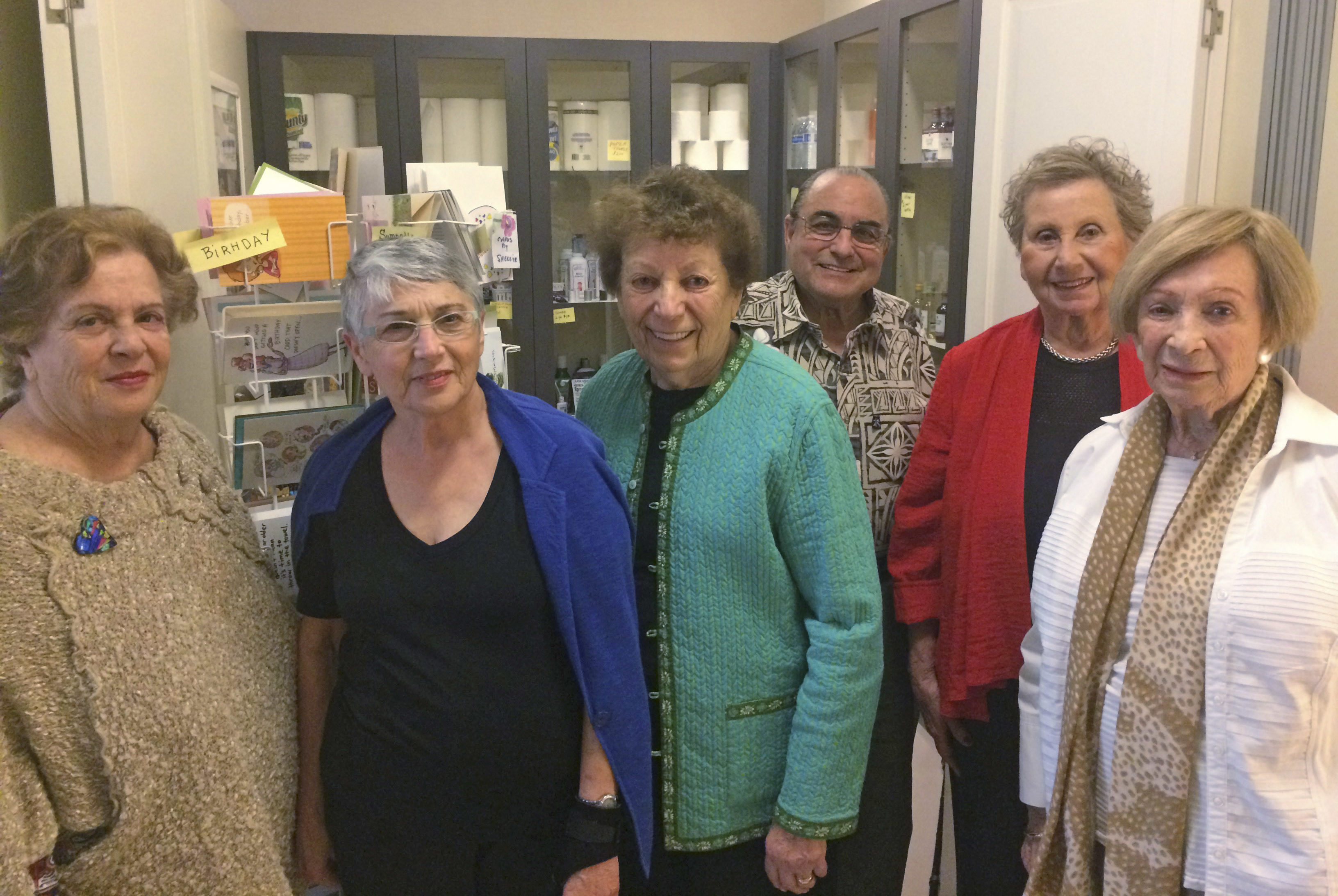 (From left) Ellen Rubinchik, Jean Myers, Shirley Milenko, Harry Rubinchik, Carole Stein and Zdenka Levy in front of This and That (Photo/Rob Gloster)
