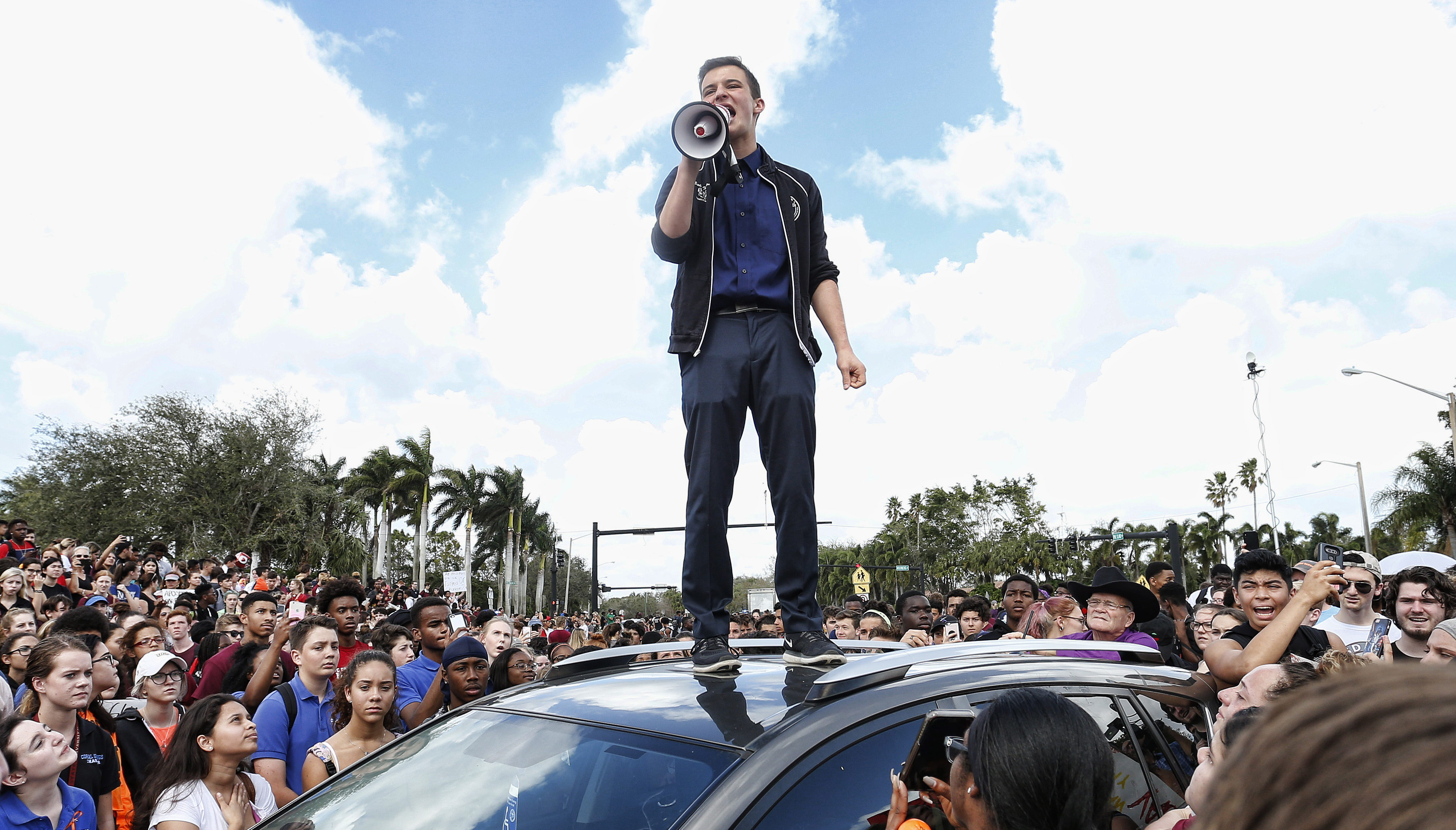 Marjory Stoneman High School student Cameron Kasky addressing area students as they rally at his school after participating in a countywide school walkout in Parkland, Fla., Feb. 21, 2018. (Photo/JTA-Rhona Wise-AFP-Getty Images)