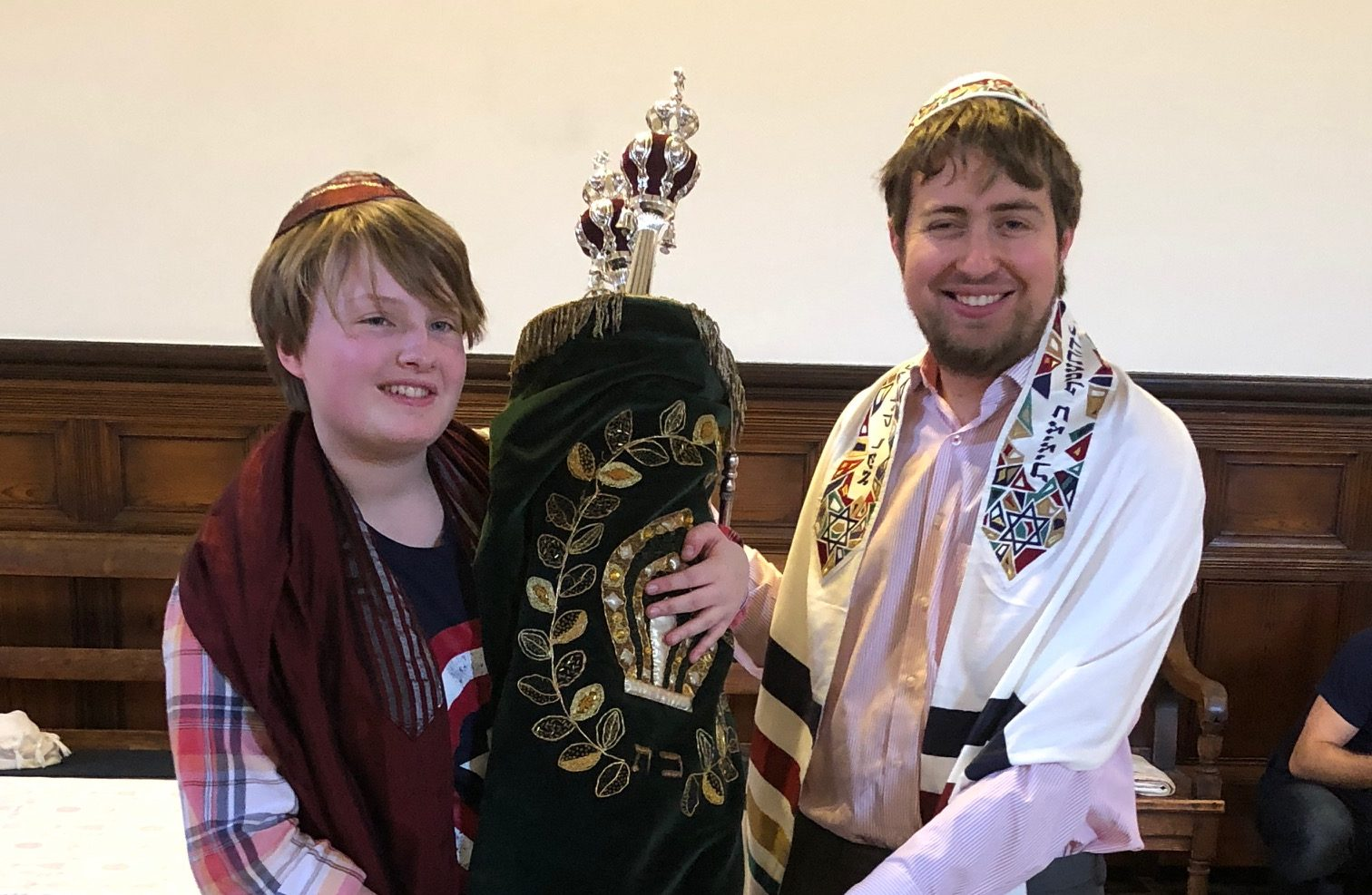 Esther Thorpe, left, identifies as non-binary and had a gender-neutral b'nei mitzvah ceremony with the help of rabbinical student Gabriel Webber.  (Photo/JTA-Courtesy of Miriam Taylor Thorpe)