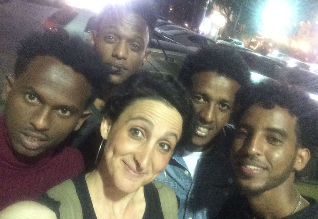 Maayan Ravid with asylum seekers Aman,Dejen, Shishay and Sammy in Tel Aviv
