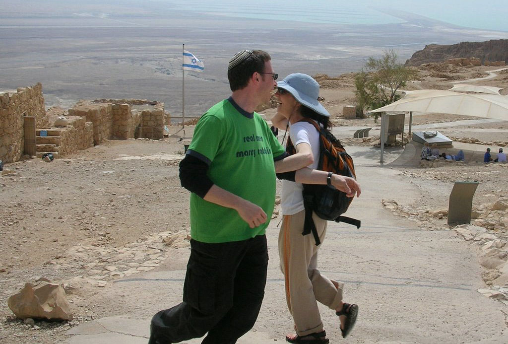 Chai Levy dances with Roger Studley after his marriage proposal on Masada during a 2006 congregational trip.