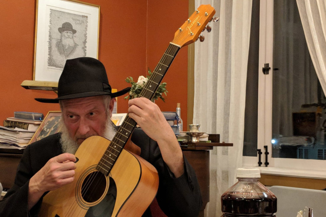 When the meal was over, Rabbi Ferris and others brought out guitars for a little post-Passover jam sesh. (Photo/David A.M. Wilensky)