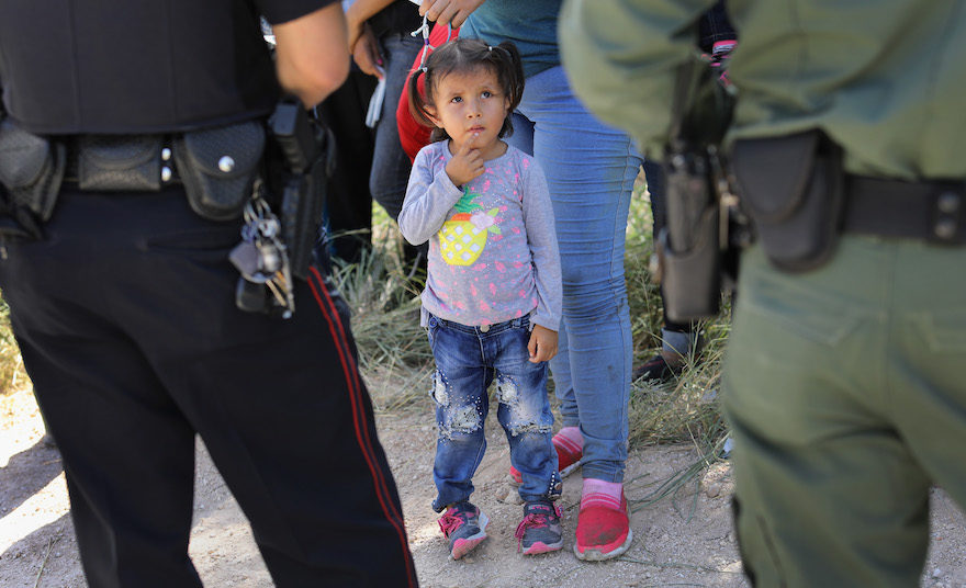 Officers taking a group of Central American asylum seekers into custody near McAllen, Texas, June 12, 2018. (Photo/JTA-John Moore-Getty Images)
