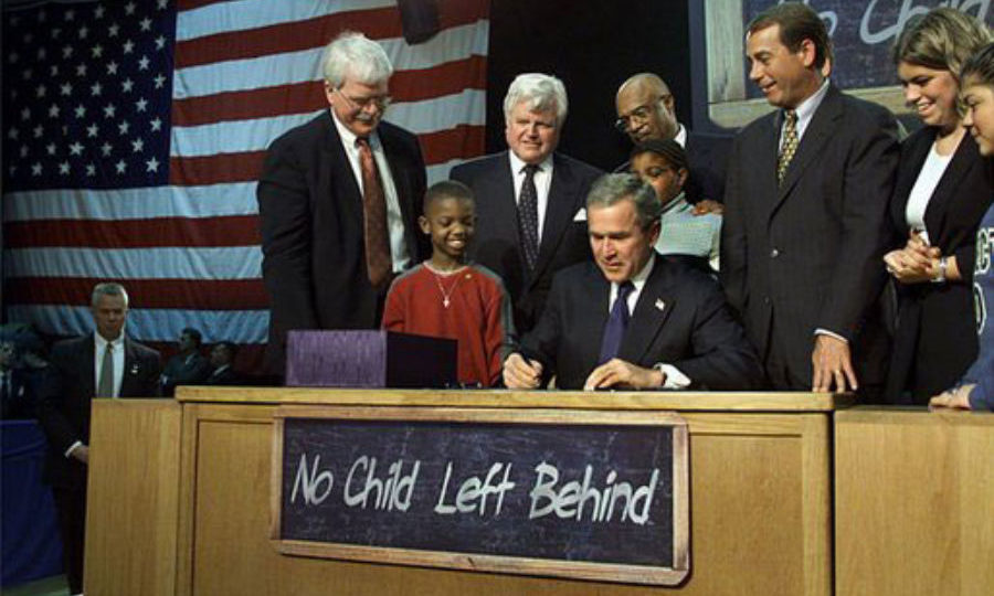 President George W. Bush signs the No Child Left Behind Act into law in 2002