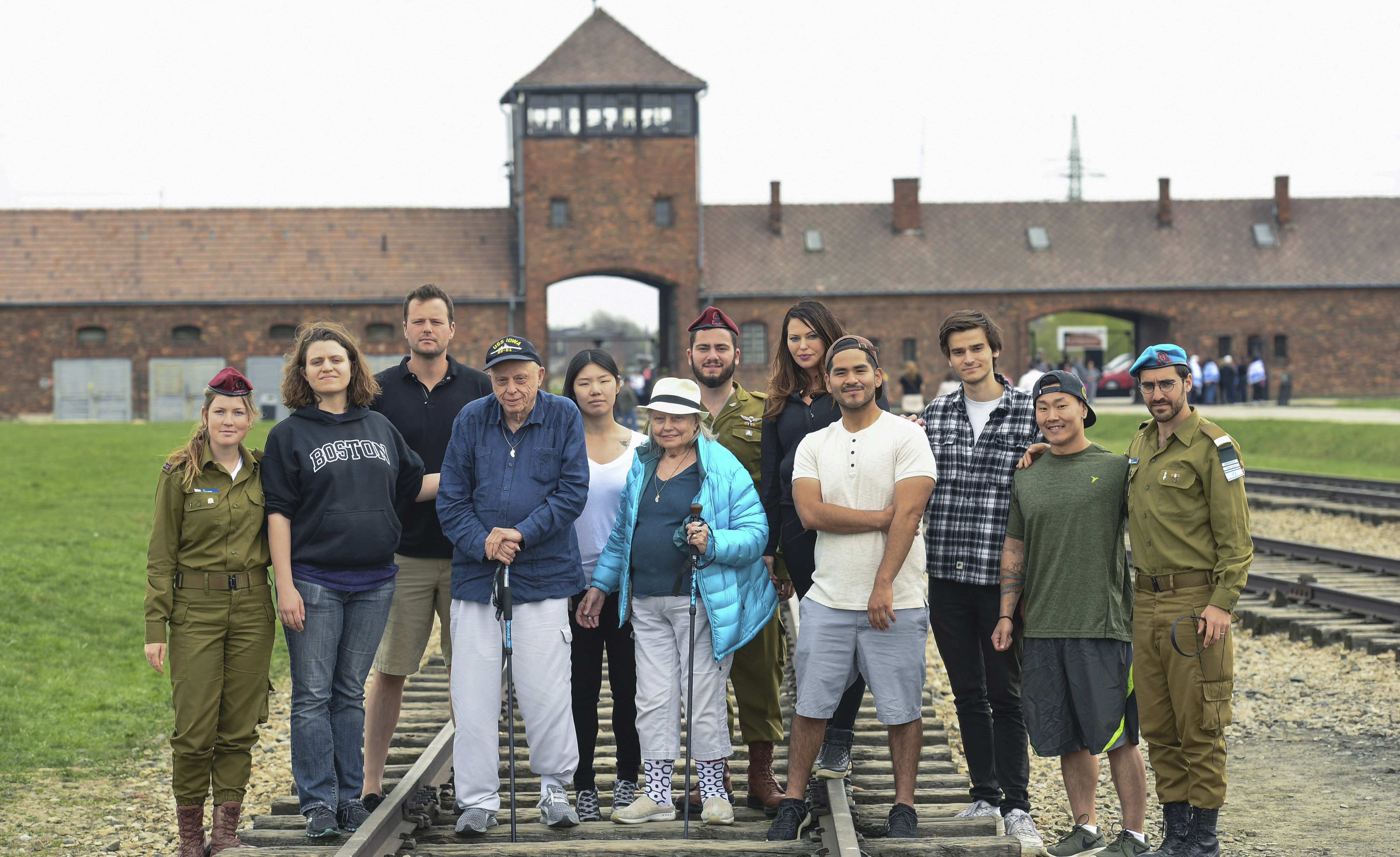 The Calvin family with IDF soldiers on the tracks leading to Auschwitz-Birkenau on April 15 (Photo/Shahar Azran)