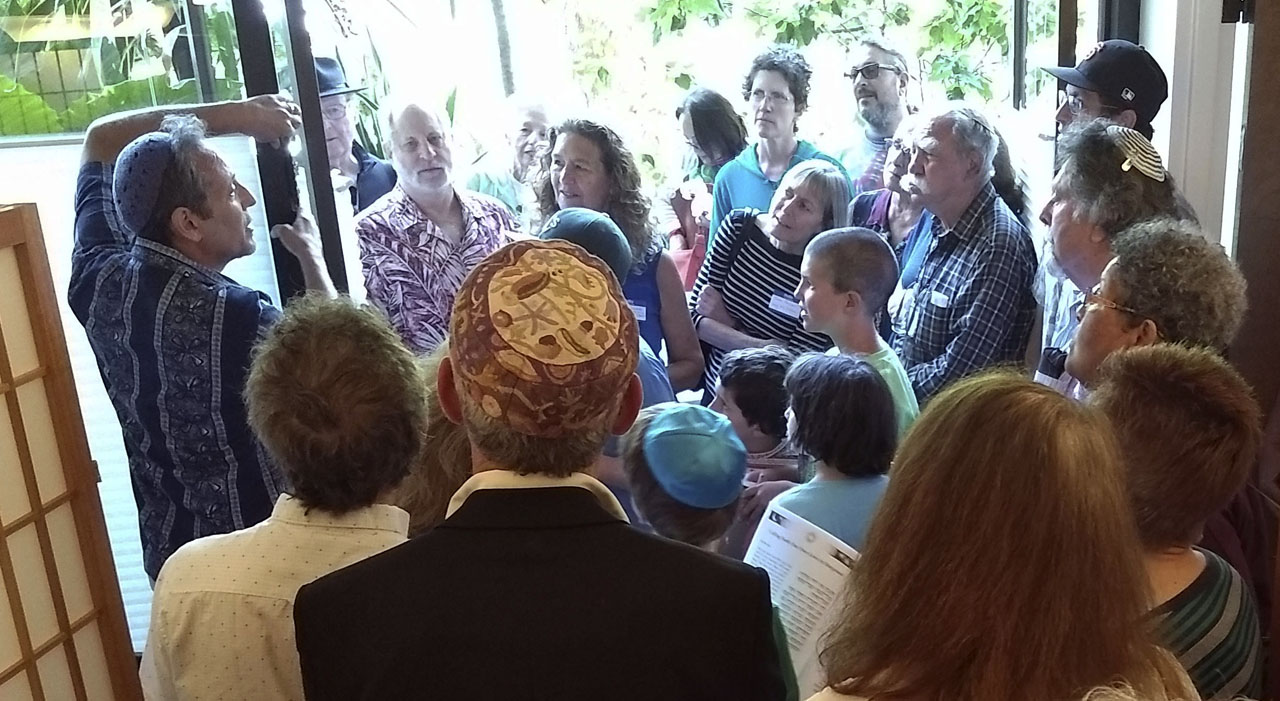 A collective of different faith communities attended the mezuzah ceremony in The Downtown Shul's new space in Santa Cruz on June 10. (Photo/Akindele Bankole)