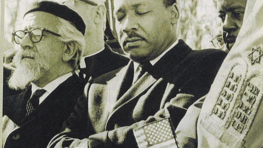 Rabbi Abraham Joshua Heschel (left) and Martin Luther King (center) marching in Selma, Alabama