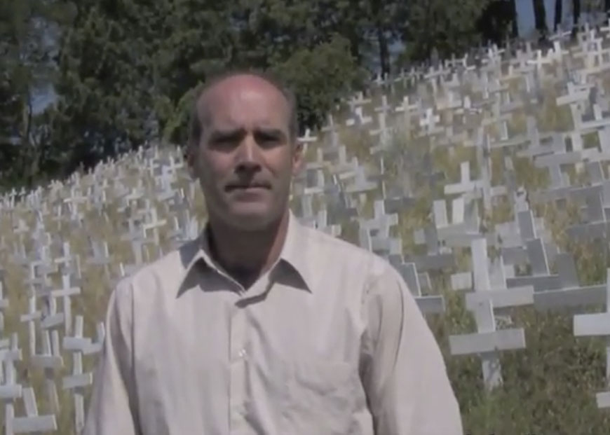 John Fitzgerald calls for a new investigation into 9/11 in 2010, standing on a Lafayette hillside where 5,000 crosses represent fallen soldiers in Iraq. (Photo/YouTube)