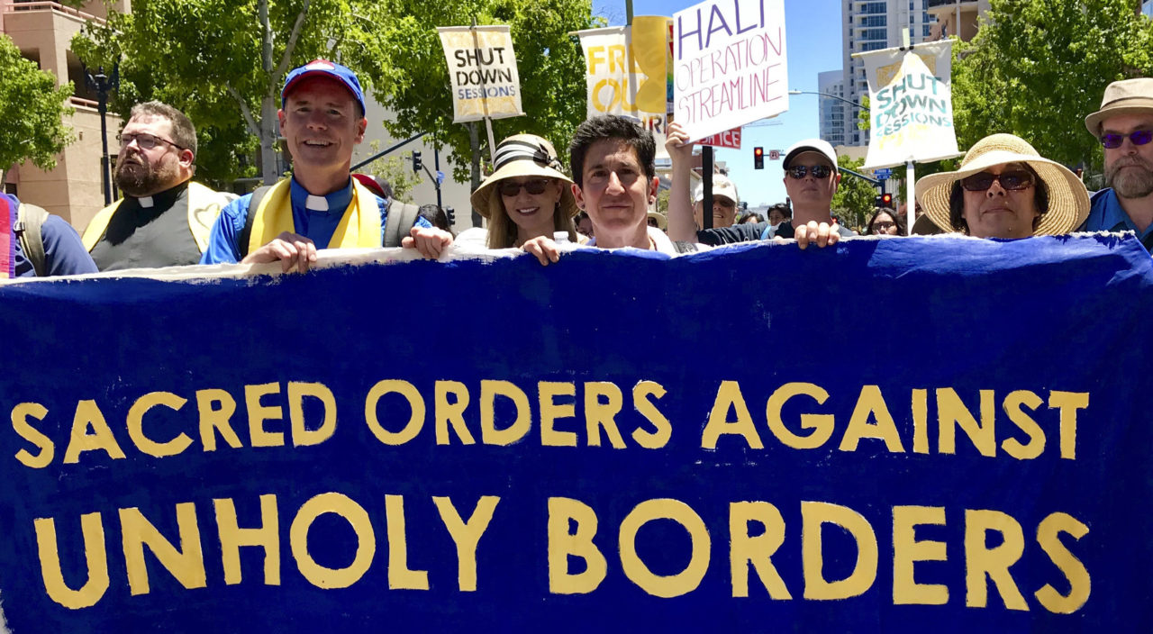 Rabbi Sydney Mintz (center) of Congregation Emanu-El in San Francisco marches with other faith leaders at a protest in San Diego on July 2. (Photo/Ellen Fleishhacker)