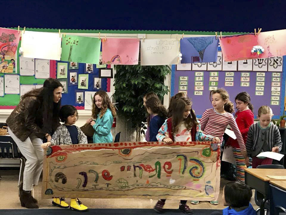 Students at Tehiyah Day School study and celebrate their Jewish heritage.