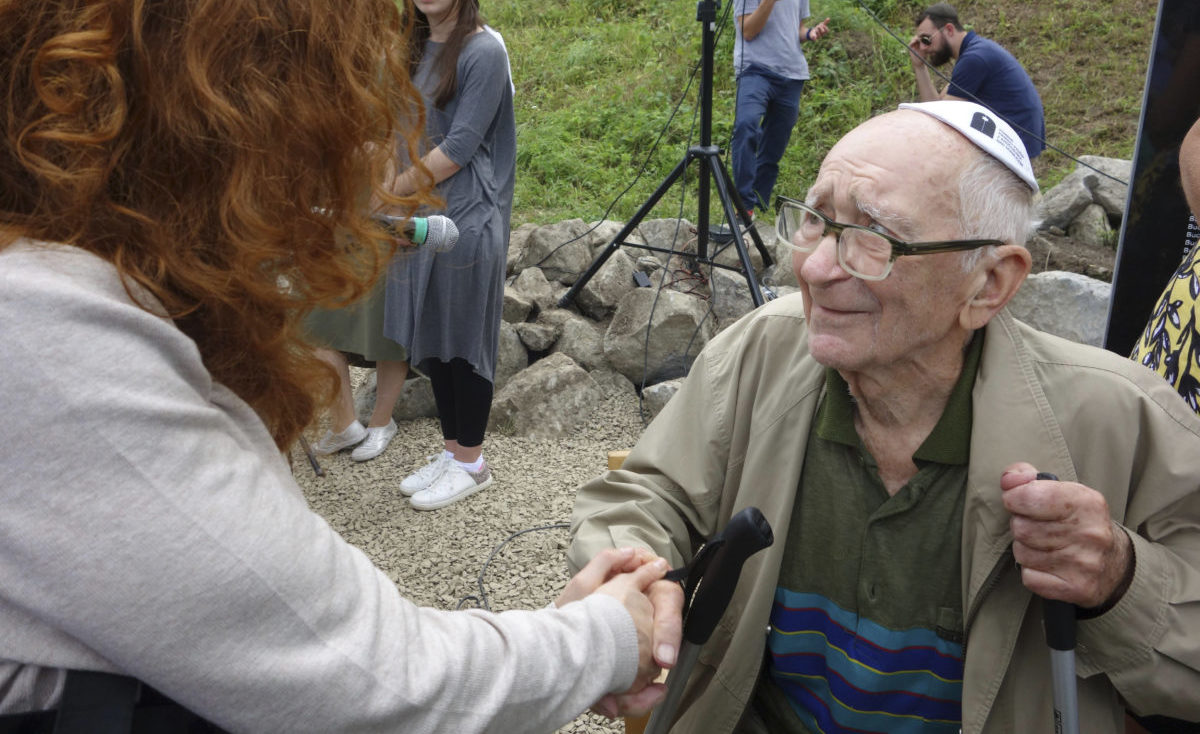 A 93-year-old witness spoke at the unveiling about being a teenager when the Nazis used Kroscienko as a mass grave. (Photo/Jesse Mintz-Roth)