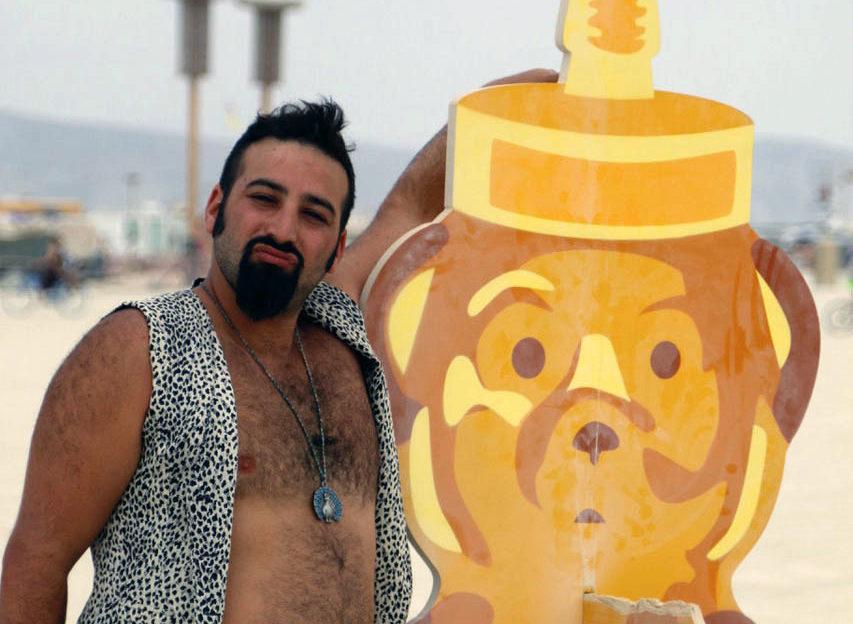 "Josh Zeldner with his honey bear ""spirit animal"" on the playa at Burning Man 2014"