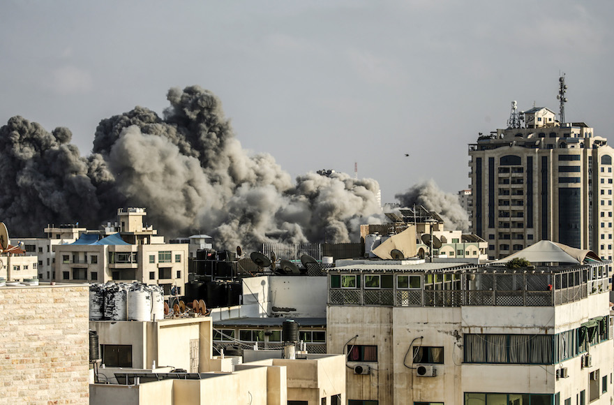 Smoke plumes rising following an Israeli air strike in Gaza City, July 14, 2018, in retaliation for Hamas rockets sent into southern Israel (Photo/JTA-Mahmud Hams-AFP-Getty Images)