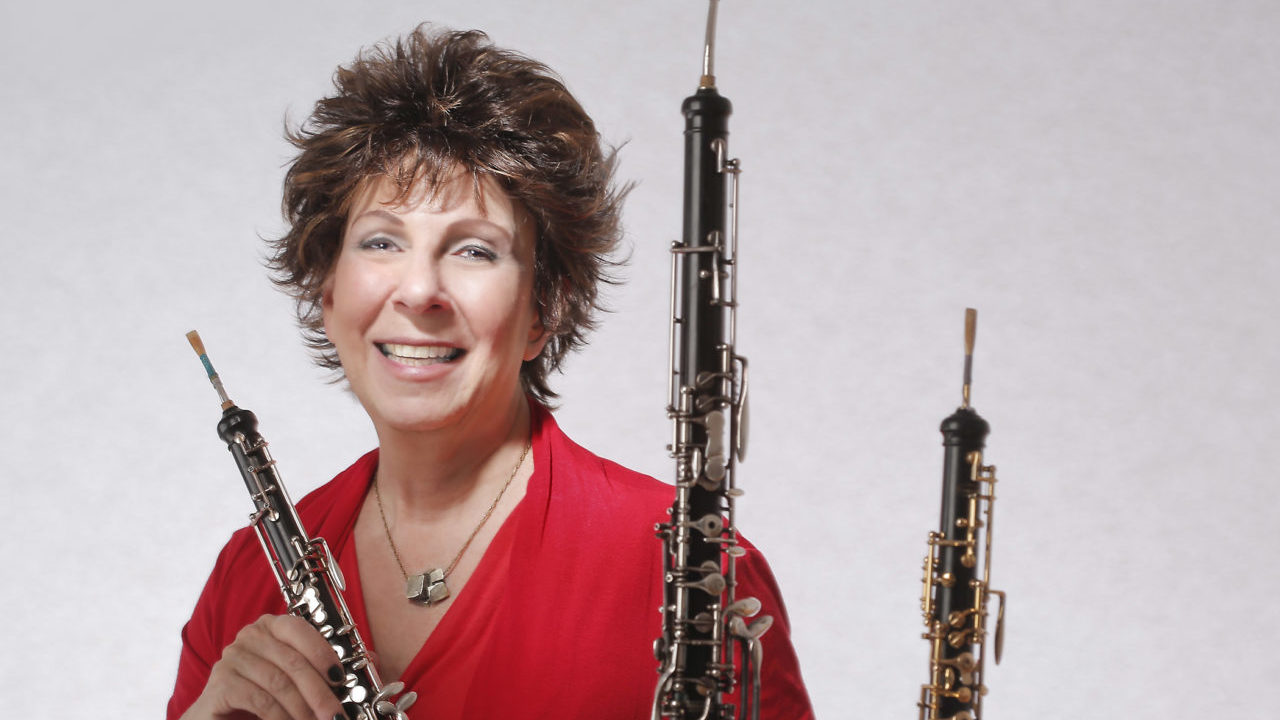 she smiles, holding up an oboe