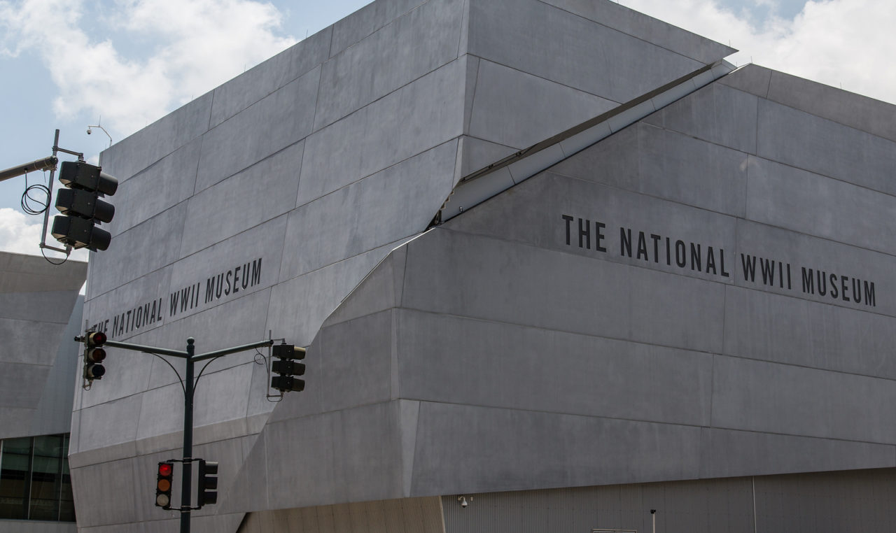 """a gray modern building with """"New Orleans WWII Museum written on it"""
