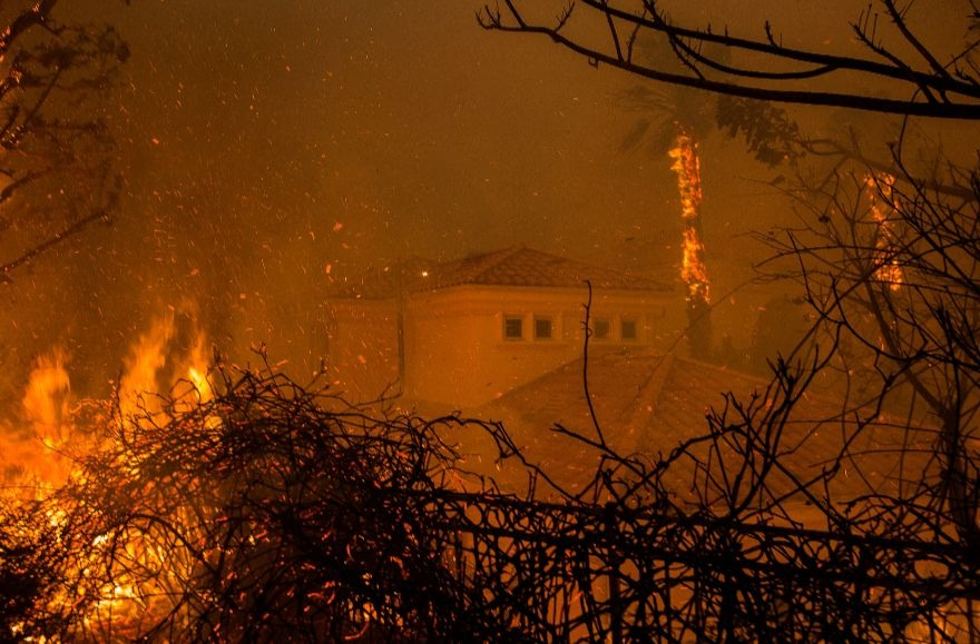 Flames surround a house in Malibu, where the Woolsey Fire led to the evacuation of thousands of homes, Nov. 2018. (Photo/JTA-David McNew-Getty Images)
