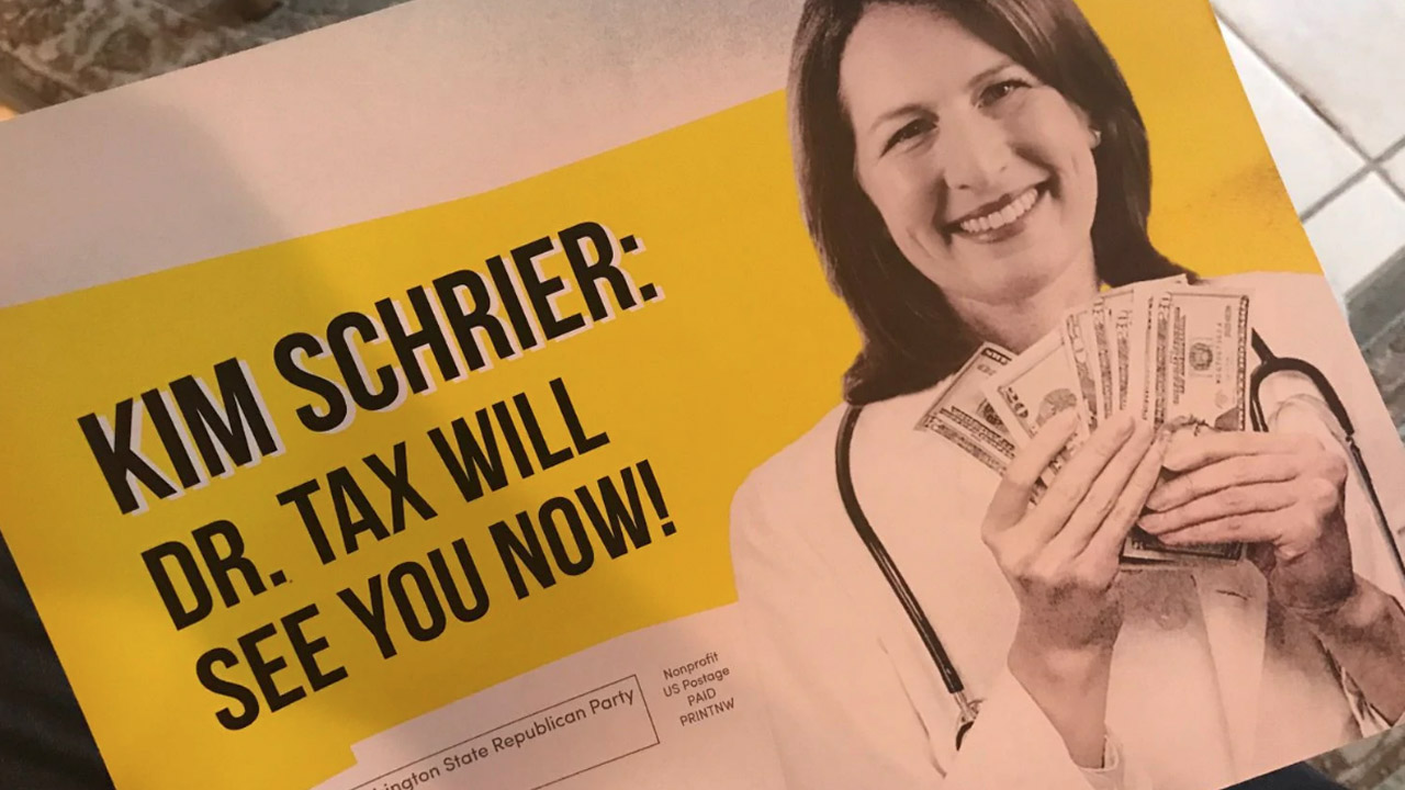 "The ad reads: ""Dr. Tax Will See You Now"" and shows Schrier holding a wad of cash"