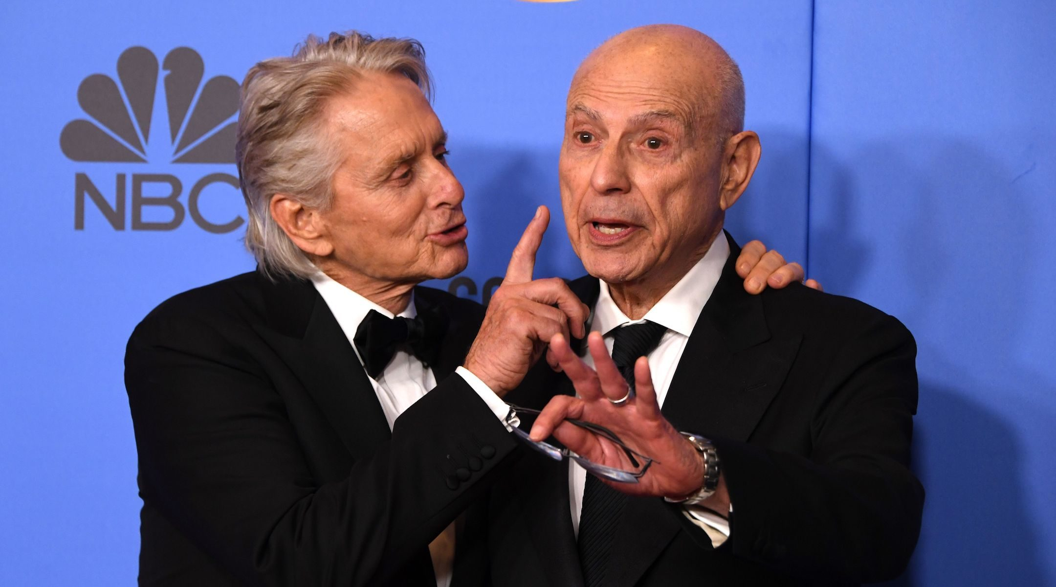 Michael Douglas, left, and Alan Arkin have some fun after winning big at the 76th annual Golden Globe Awards in Beverly Hills, Calif., Jan. 6, 2019. (Photo/JTA-Mark Ralston-AFP-Getty Images)