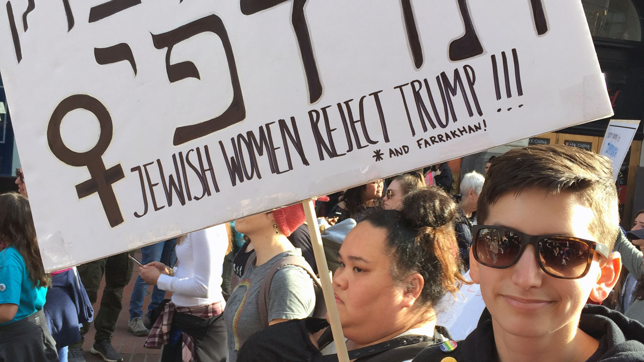 """Sapphire, age 27, originally from Israel, carried a sign at the 2019 San Francisco Women's March that said in Hebrew """"justice, justice, I shall pursue,"""" a paraphrase of a well-known biblical line. (Photo/Sue Barnett)"""