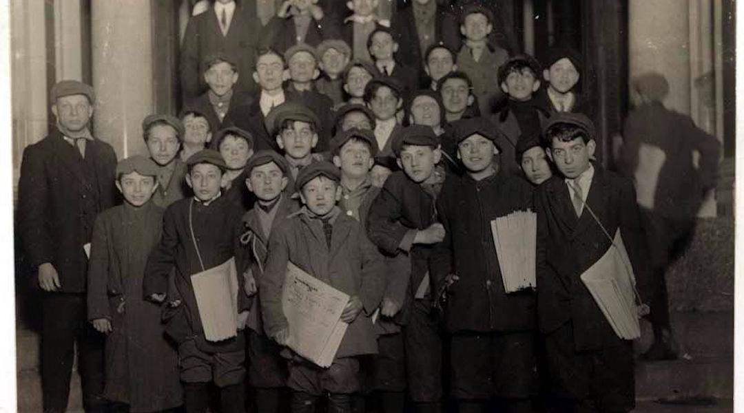 Newsboys for the Forward wait for their copies in the early morning hours, March 1913. (Photo/Wikimedia-Lewis Hine)