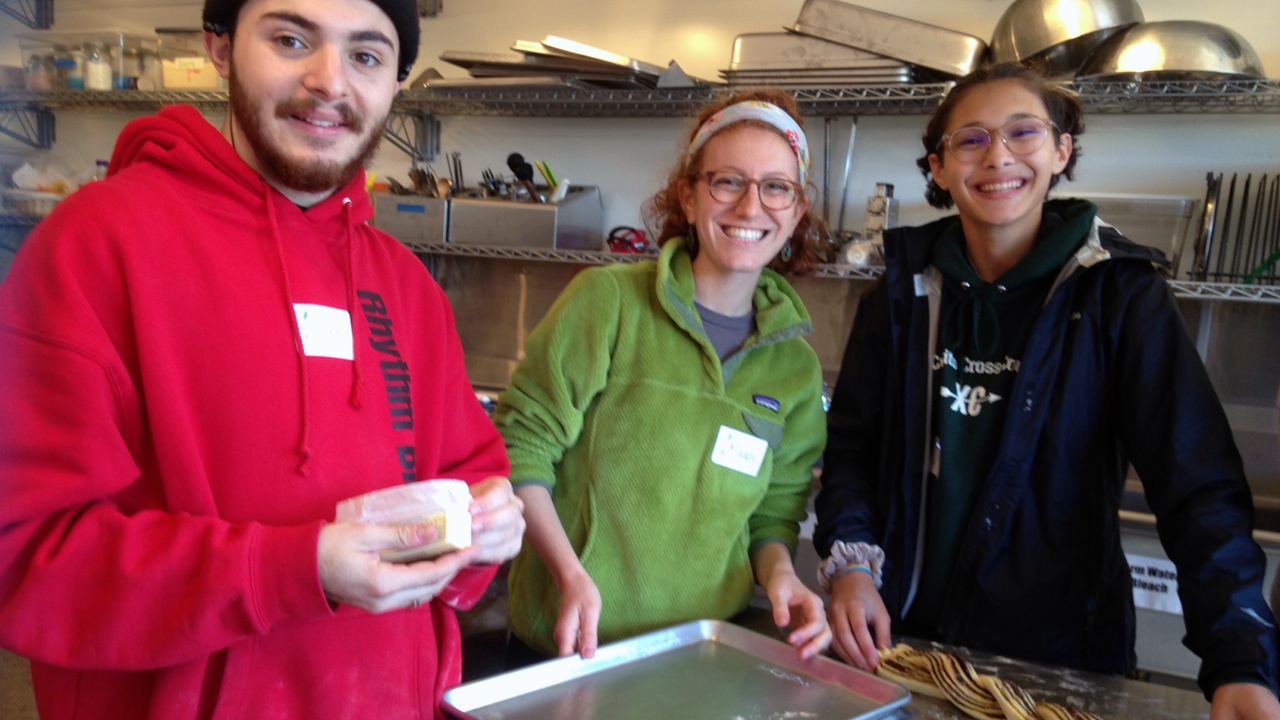 Ilya Varga (left) with Maddy Winard and Olivia Rokhsar making babka in the Urban Adamah kitchen. (Photo/Lezak Shallat)