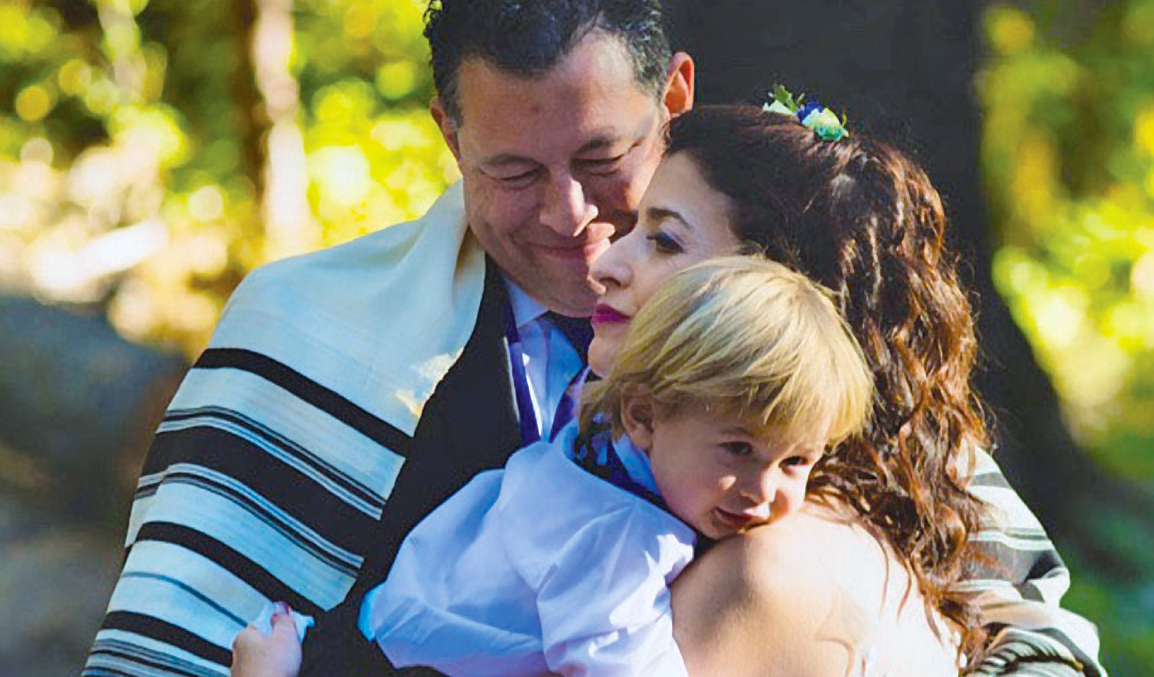 Rebecca Katz and Darian Heyman with their son, Rafi, at their September 2018 wedding
