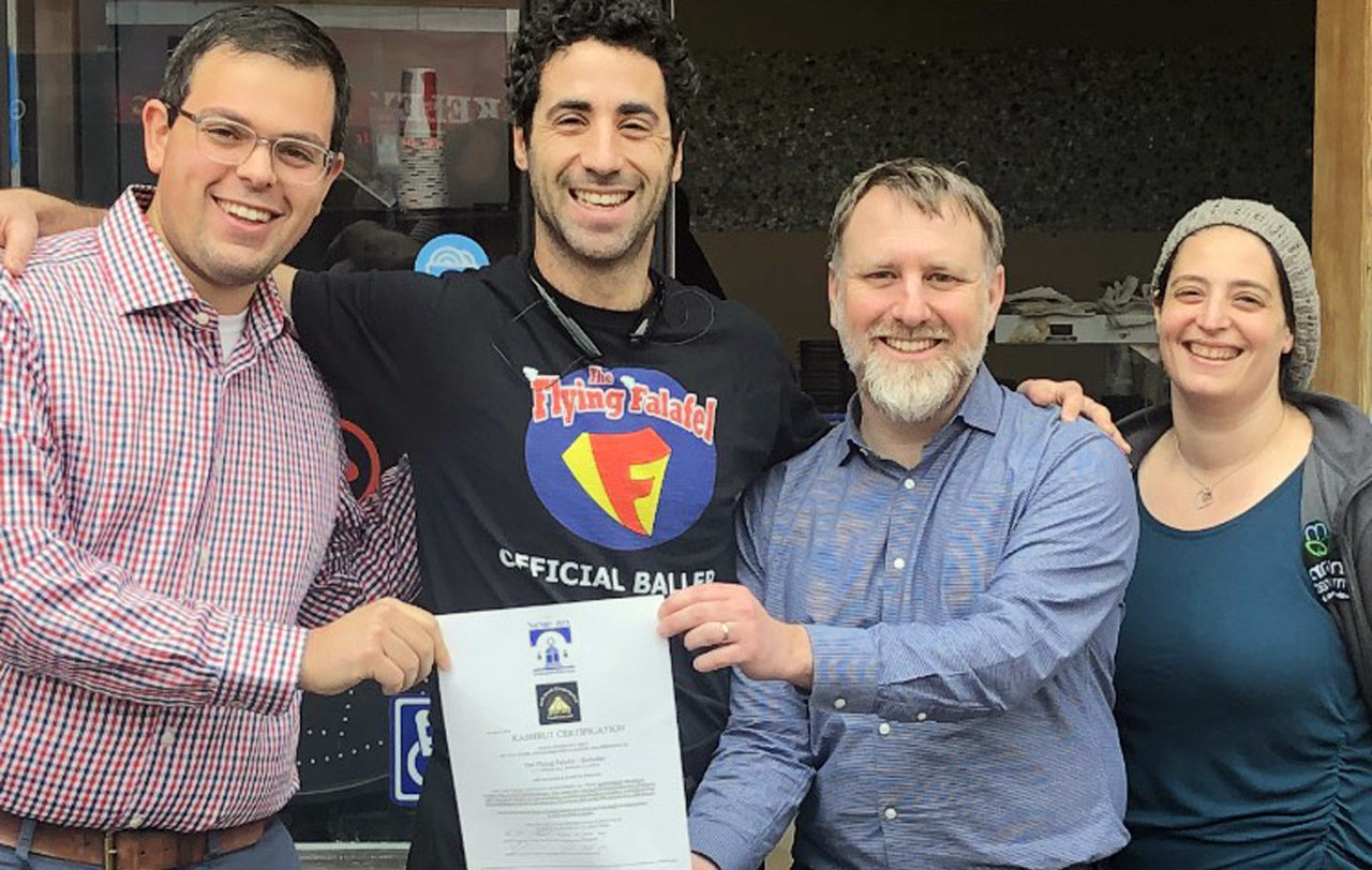 Rabbi Gershon Albert, Flying Falafel owner Assaf Pashut, Rabbi Yonatan Cohen and Maharat Victoria Sutton show off Flying Falafel's new kosher certification.