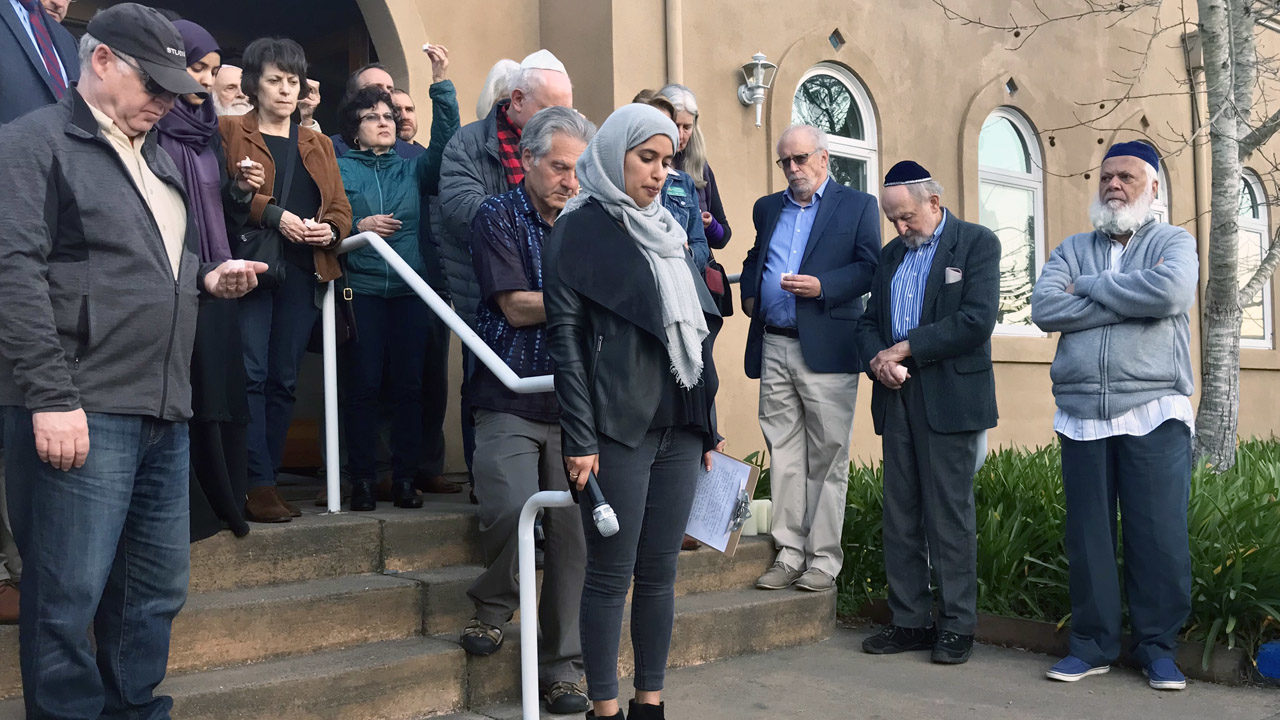 Fatima Hansia leads a moment of silence for the victims of the mosque shootings in New Zealand at a vigil at Islamic Center of Mill Valley, March 15, 2019. (Photo/Arno Rosenfeld)