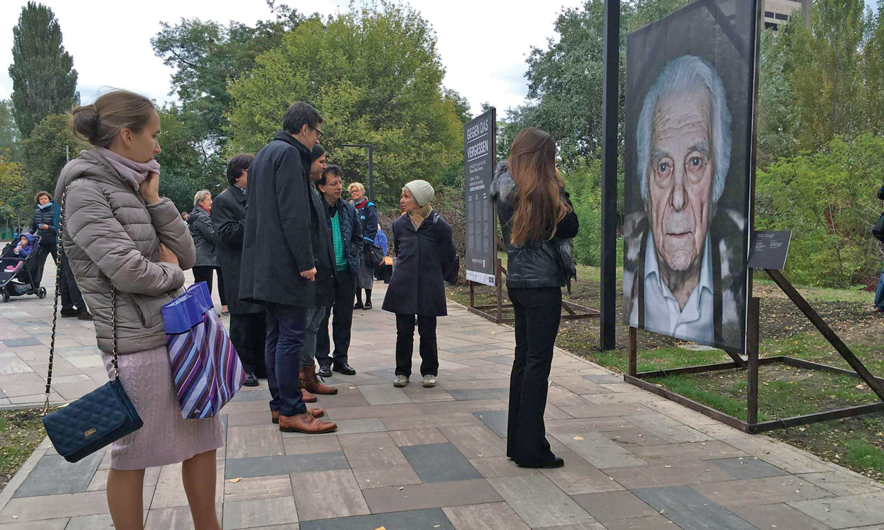 Luigi Toscano's traveling exhibit, seen here in Ukraine, displays portraits of Holocaust survivors who live in the place where the exhibit is on display.