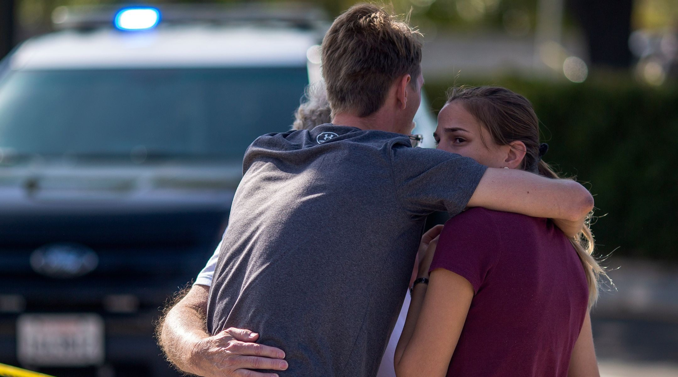 People embrace outside the Chabad of Poway, after a gunman opened fire during services on the last day of Passover, April 27, 2019, leaving one person dead and three others injured. (Photo/JTA-David McNew-Getty Images)