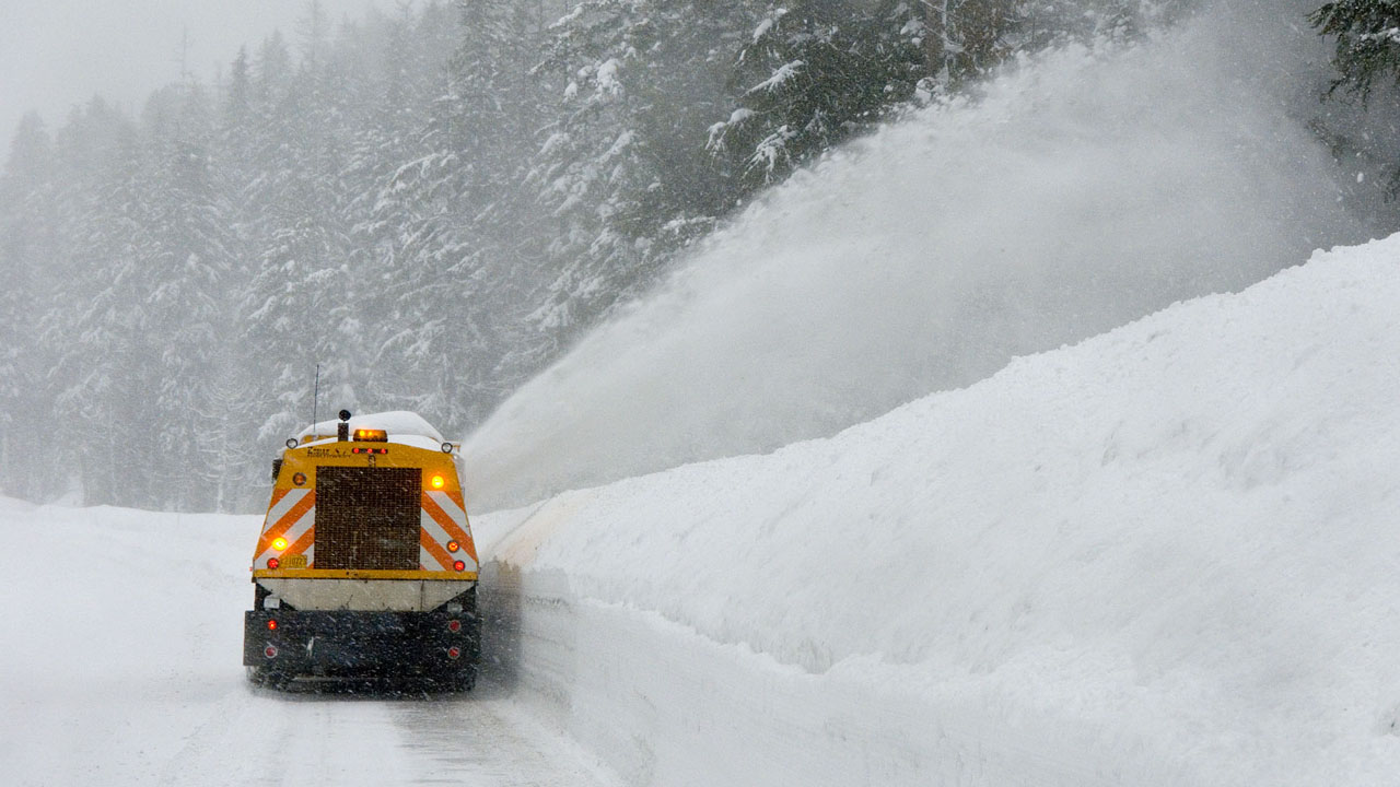 a snowplow plowing through snow
