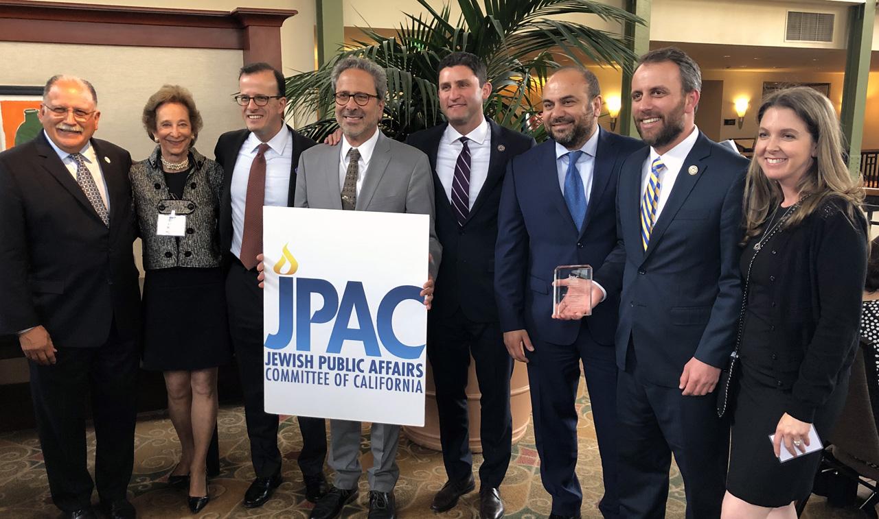 (From left) Assembly member Jose Medina, JPAC board chair Lynn Bunim, Assembly members Marc Berman, Richard Bloom, Jesse Gabriel, Adrin Nazarian and Marc Levine; and JPAC executive director Julie Zeisler. (Photo/Courtesy JPAC)