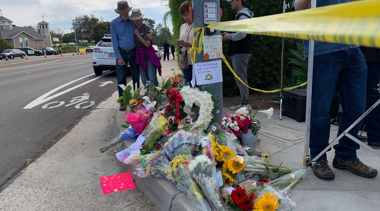 Mourners leave mementos across the street from the Chabad Community Center in Poway, April 29, 2019. (Photo/JTA-Gabrielle Birkner)