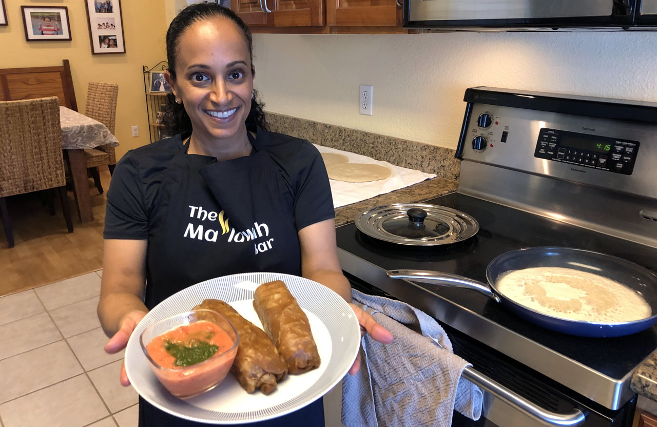 Ma'lawach Bar owner Doreet Jehassi has a lachuch cooking on the stovetop while she shows off her jachnun, traditionally served with tomato paste and schug, in her home kitchen in Santa Clara. (Photo/Alix Wall)