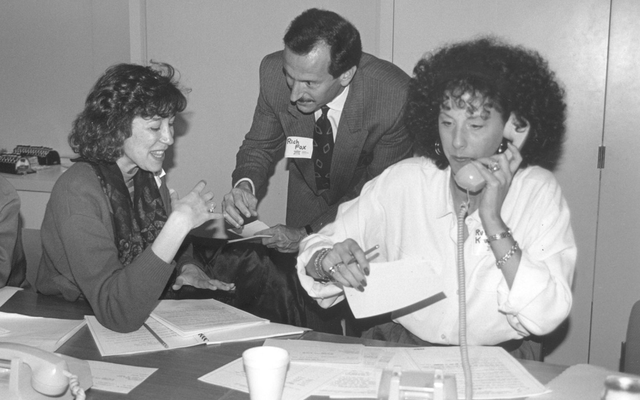 Molly Jaffe (left), Ruth Krumbein and Rich Fox get ready for the East Bay Federation's Super Sunday fundraiser on Feb. 11, 1990.
