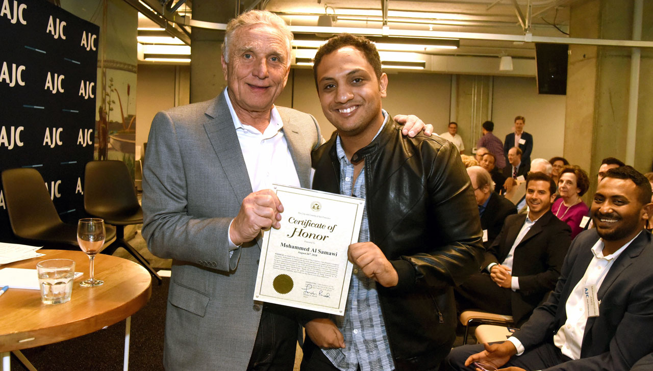 Mohammed Al Samawi, Yemeni refugee and peace activist, with Moses Libitzky, Jewish community leader, after Mohammed and Justin Hefter are honored at the SF AJC 73rd annual meeting