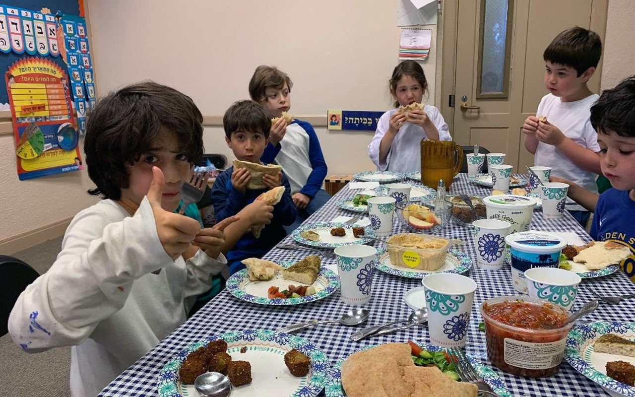 Kids enjoying a snack at Edah, a Bay Area Jewish after-school program