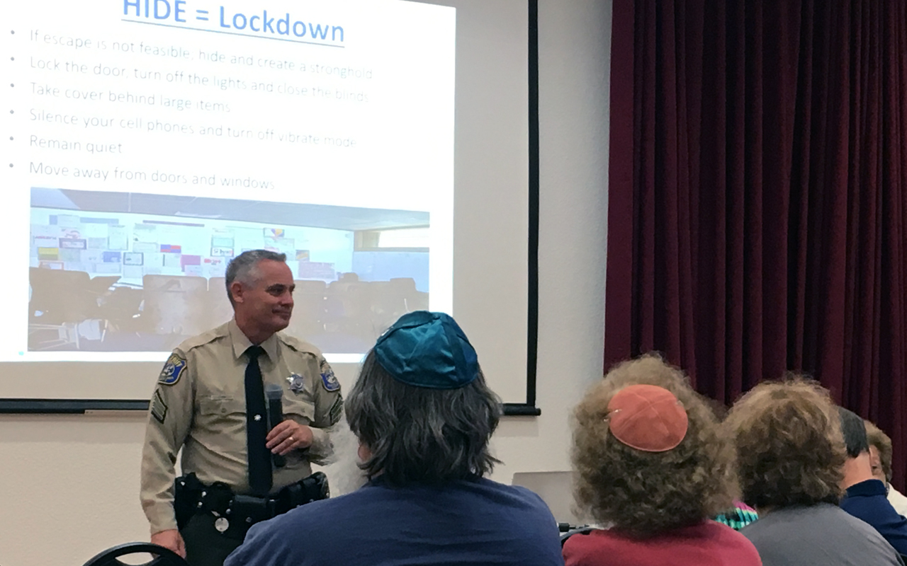 Sgt. Jim Post of the Santa Clara County Sheriff's Office leads an active shooter training at Congregation Beth David on July 14, 2019. (Photo/Gabe Stutman)