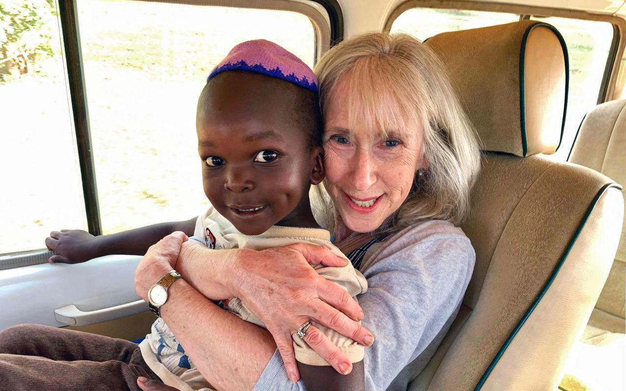 Joanne Greene with a young member of the Abayudaya Jewish community of Uganda (Photo/Fred Greene)