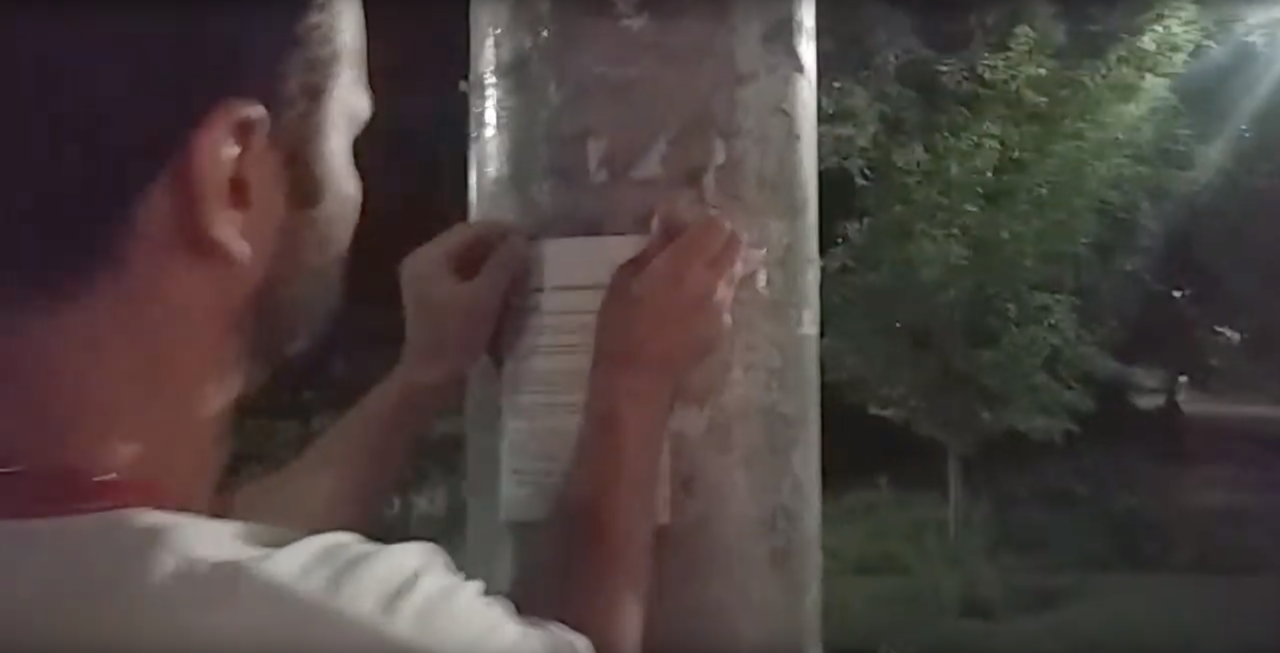 A video from the Handsome Truth channel on YouTube shows a man putting up anti-Semitic flyers in Santa Rosa (Screenshot/YouTube)