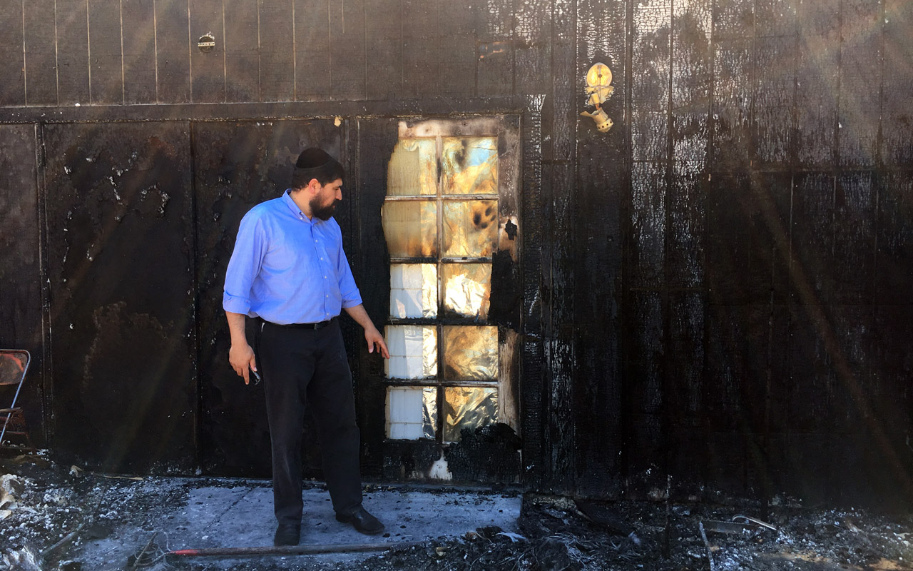 Rabbi Raleigh Resnick surveys the damage to the Chabad center he runs in Pleasanton after it was severely damaged by fire on Aug. 9. (Photo/Gabe Stutman)