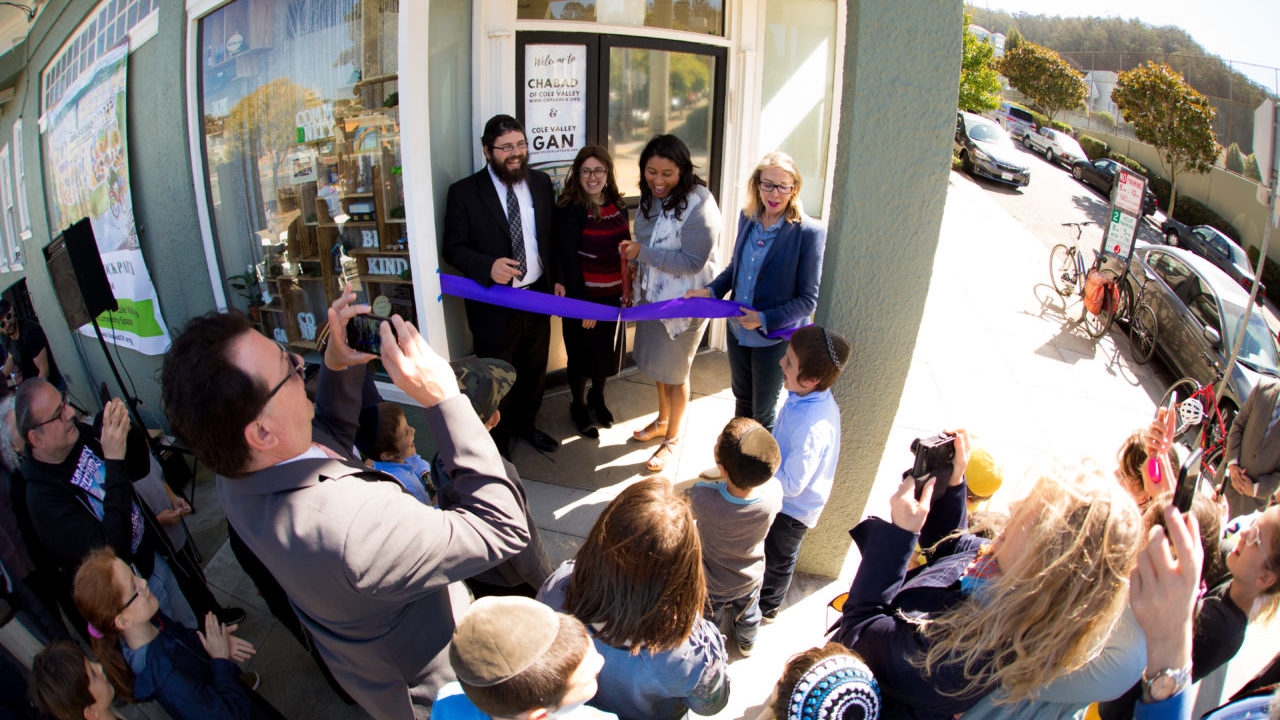(Left to right) Rabbi Nosson Potash, Chaya Potash, S.F. Mayor London Breed and S.F. Supervisor Vallie Brown at the grand opening of Chabad of Cole Valley's new space (Photo/Courtesy Chabad of Cole Valley)