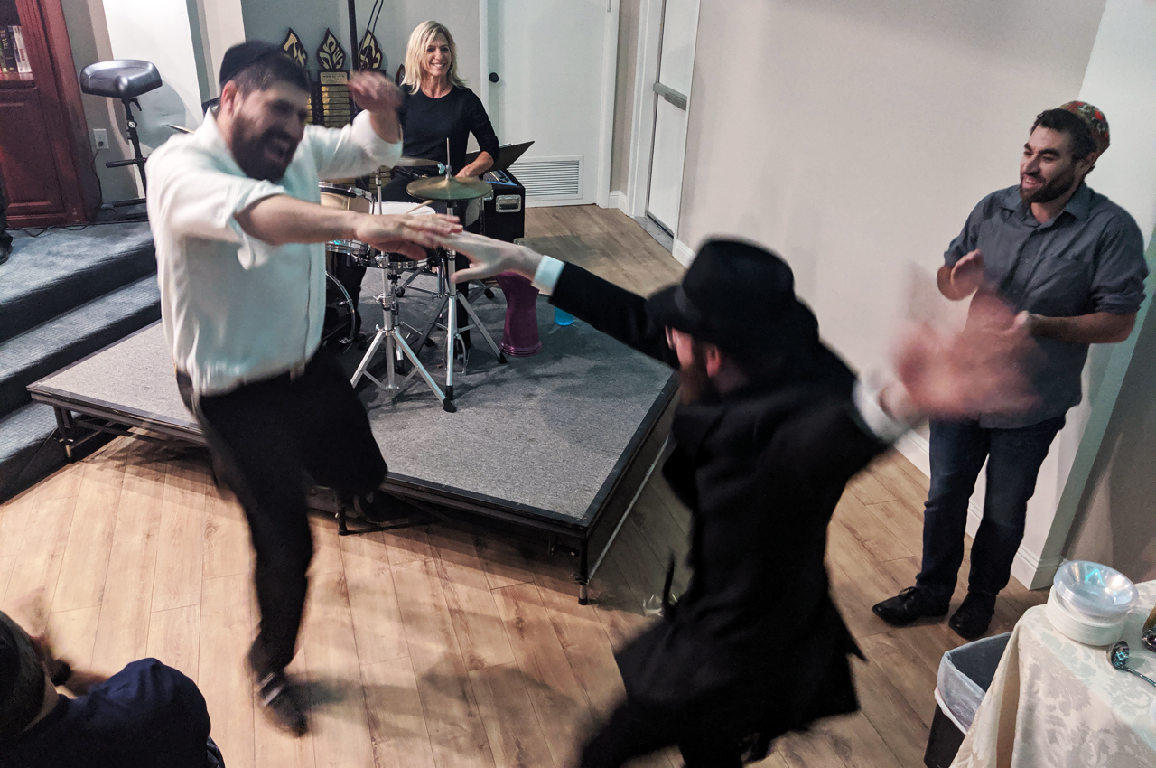 """Rabbis Raleigh Resnick (left) and Josh Zebberman dance during the """"Unity Shabbat"""" concert at Chabad of the Tri-Valley, Sept. 20, 2019. (Photo/David A.M. Wilensky"""