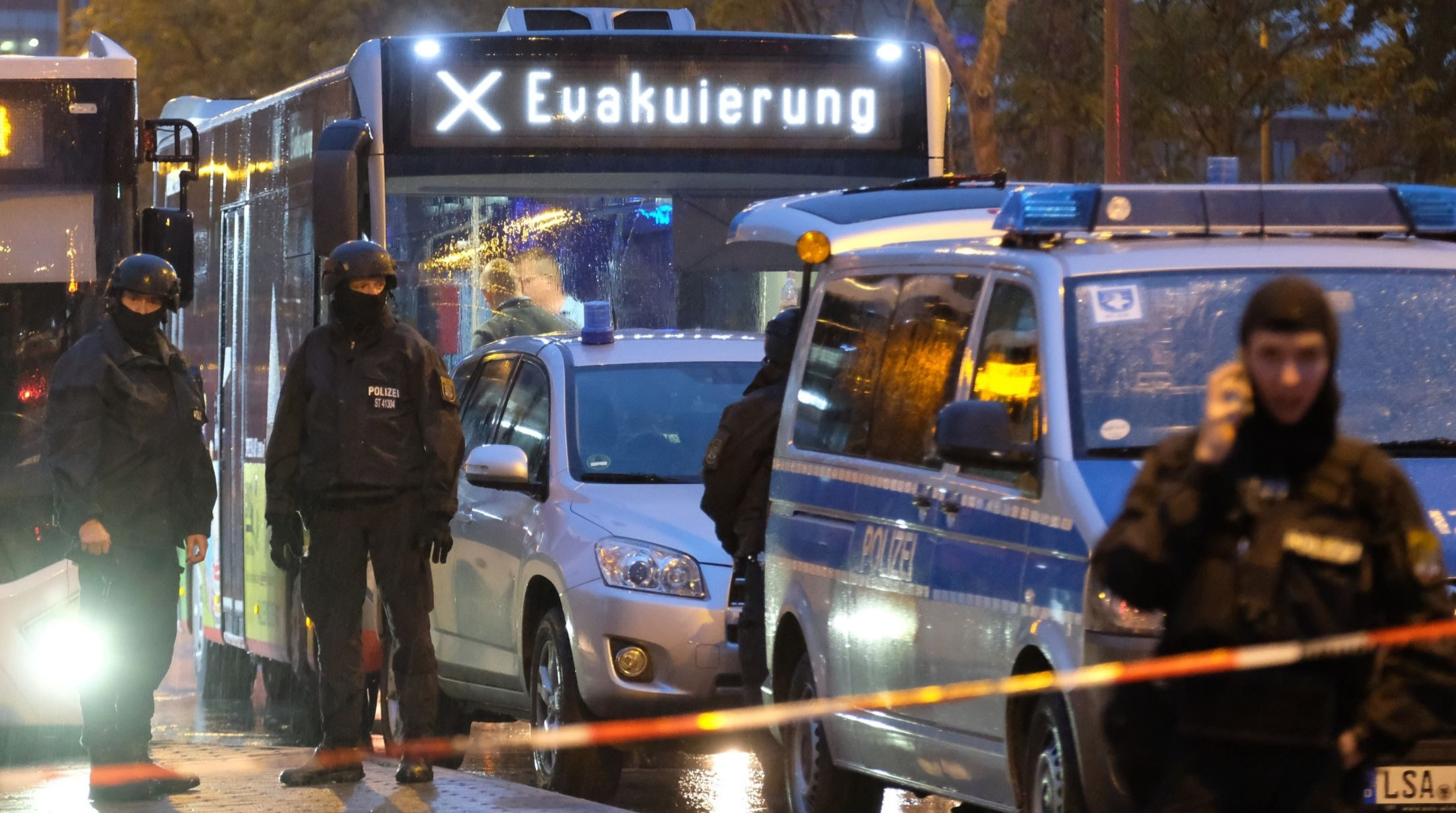 """A bus with the inscription """"evacuation"""" is escorted by police in Halle, Germany, where a gunman killed two people before being taken into custody by police, Oct. 9, 2019. (Sebastian Willnow/dpa-Zentralbild/dpa/picture alliance via Getty Images)"""