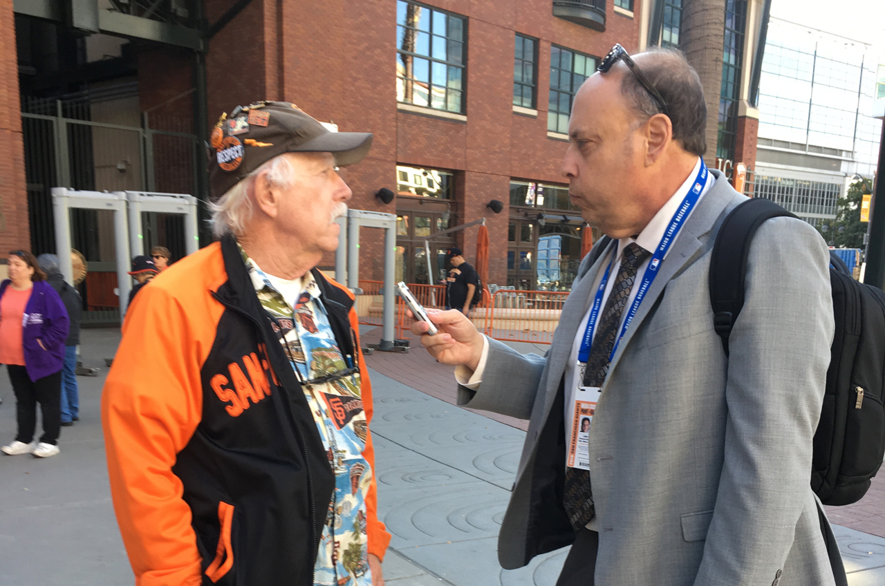 Henry Schulman (right) interviewing a man outside of Oracle Park in January before Willie McCovey's public memorial. (Photo/Courtesy Henry Schulman)