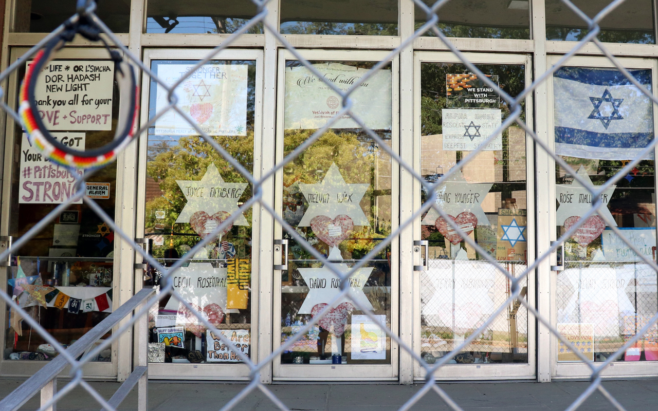 The doors of the Tree of Life synagogue feature memorials surrounding the building nearly a year after the attack there that killed 11 worshippers. (Photo/JTA-Grace Yagel)